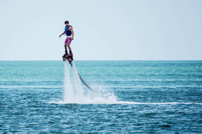 Man soars above the Gulf of Mexico off Captiva Island, Florida on a Flyboard.