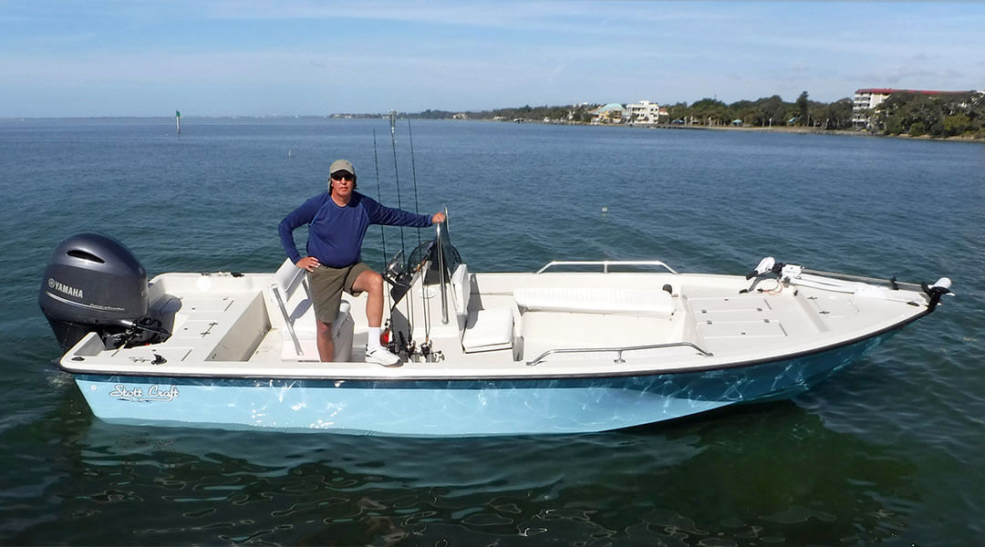 Sarasota Fishing Charters Capt. Jim Klopfer on his boat in Sarasota Bay, offers guided fishing tours in Sarasota, Florida
