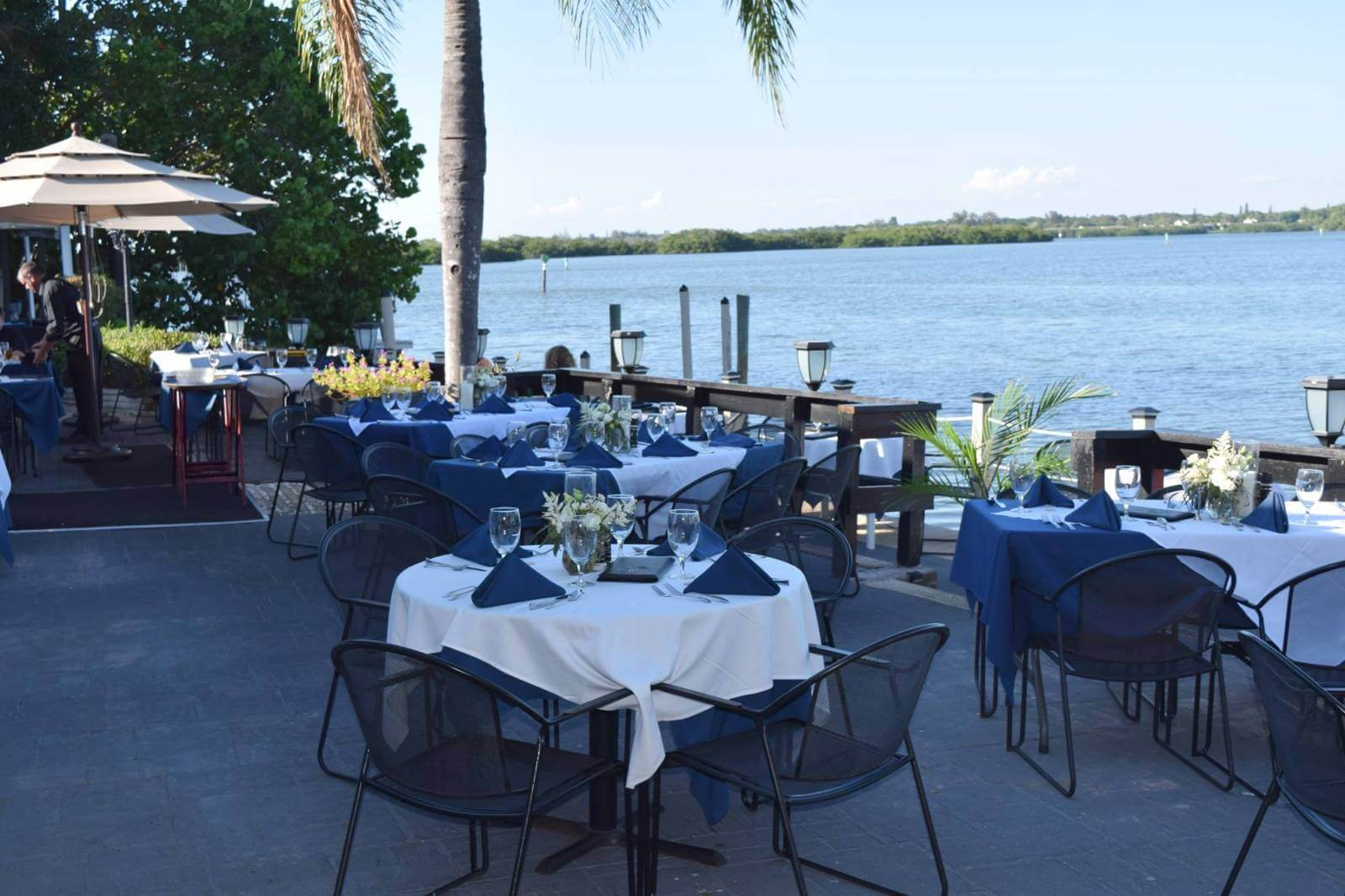 Outdoor patio Ophelia's on the Bay casual fine dining waterfront restaurant Siesta Key, Florida.