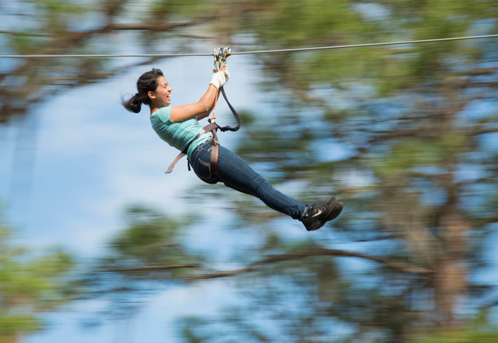 Woman smiling on an exciting biplane in the tree tops at Tree Umph Adventure Park in Bradenton, Florida