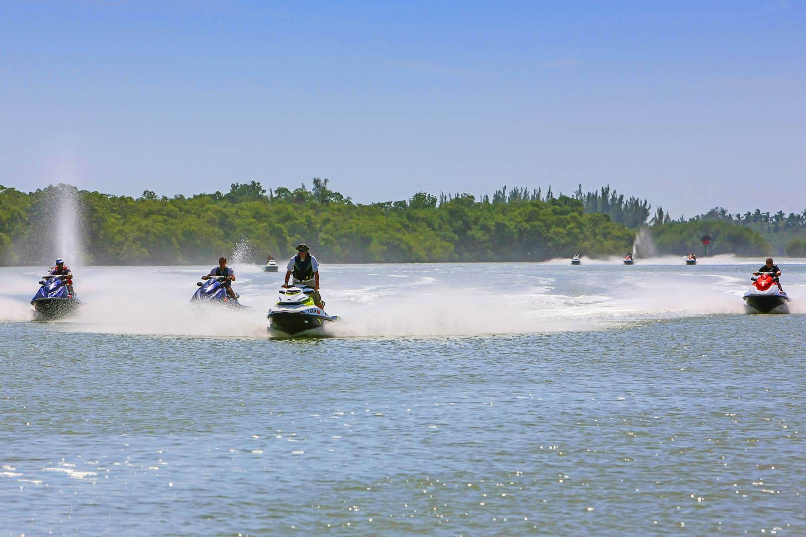 Group of jet skis on the water Naples and Marco Island, Florida. Experience the natural beauty of Naples and Marco Island, Florida with a WaveRunner tour.