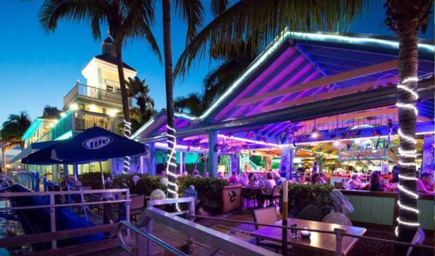 Nightlife outdoor dining at Fort Myers Beach, Florida Parrot Key Caribbean Grill casual waterfront bar and restaurant. | MustDo.com