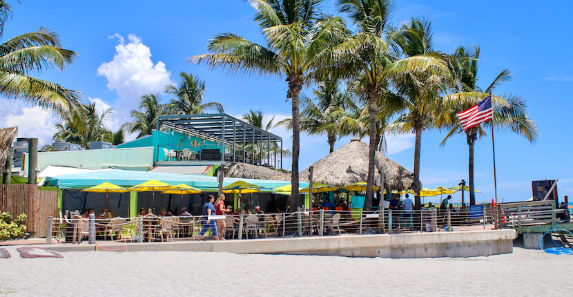 Sharky's on the Pier is a popular beachfront bar and restaurant spot located directly on the Gulf of Mexico in Venice, Florida. Photo by Nita Ettinger. Must Do Visitor Guides MustDo.com