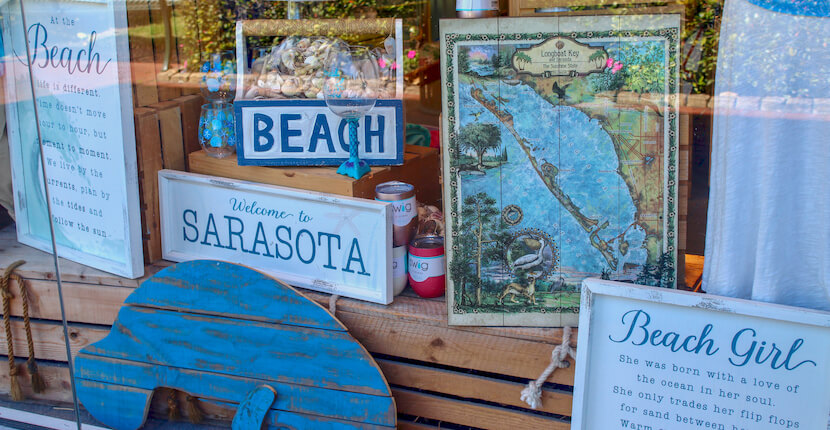 Souvenirs in the window St. Armands Circle in Sarasota, Florida features more than 140 boutiques, specialty shops, galleries, and restaurants and is located just minutes from Lido Beach. Photo by Nita Ettinger. Must Do Visitor Guides | MustDo.com
