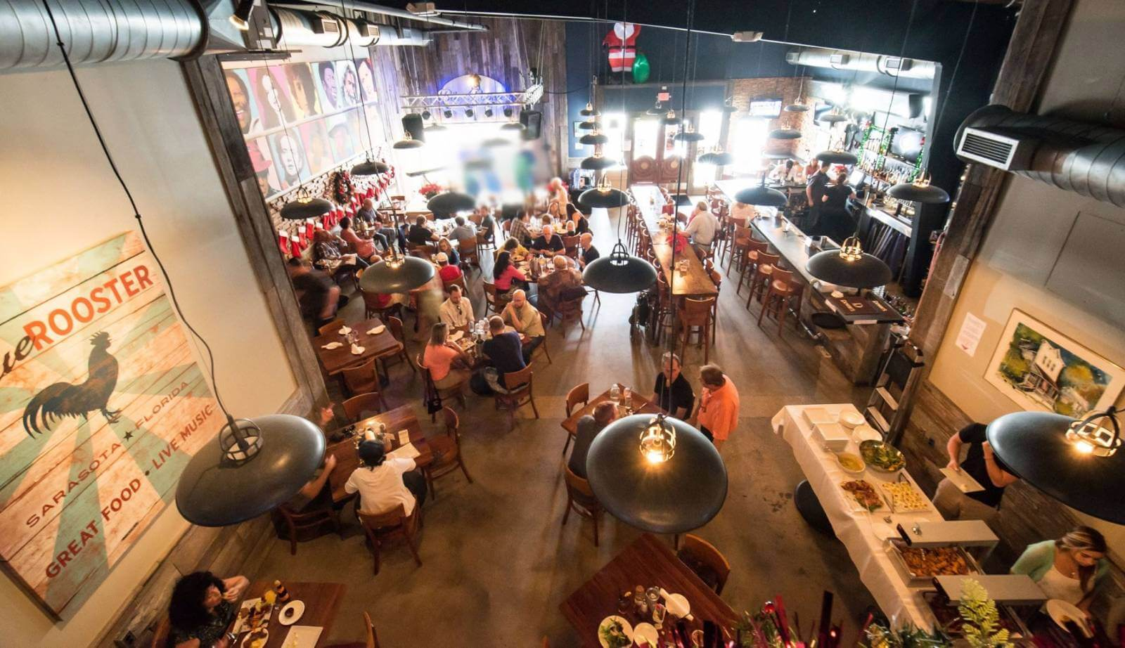 View of the dining room at The Blue Rooster bar and restaurant downtown Sarasota, Florida.