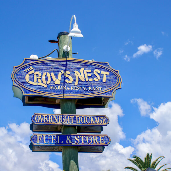 Sign for The Crow's Nest waterfront restaurant and bar Venice, Florida. Photo by Nita Ettinger. Must Do Visitor Guides, MustDo.com