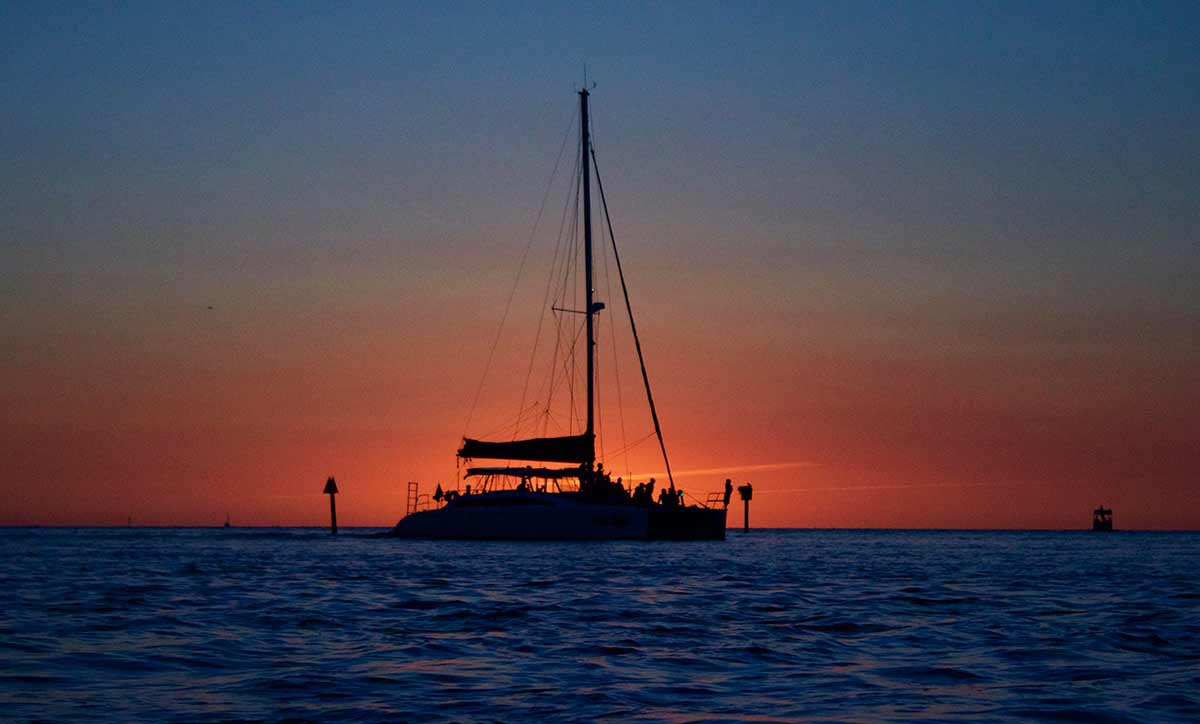 Sailboat with sunset on the horizon