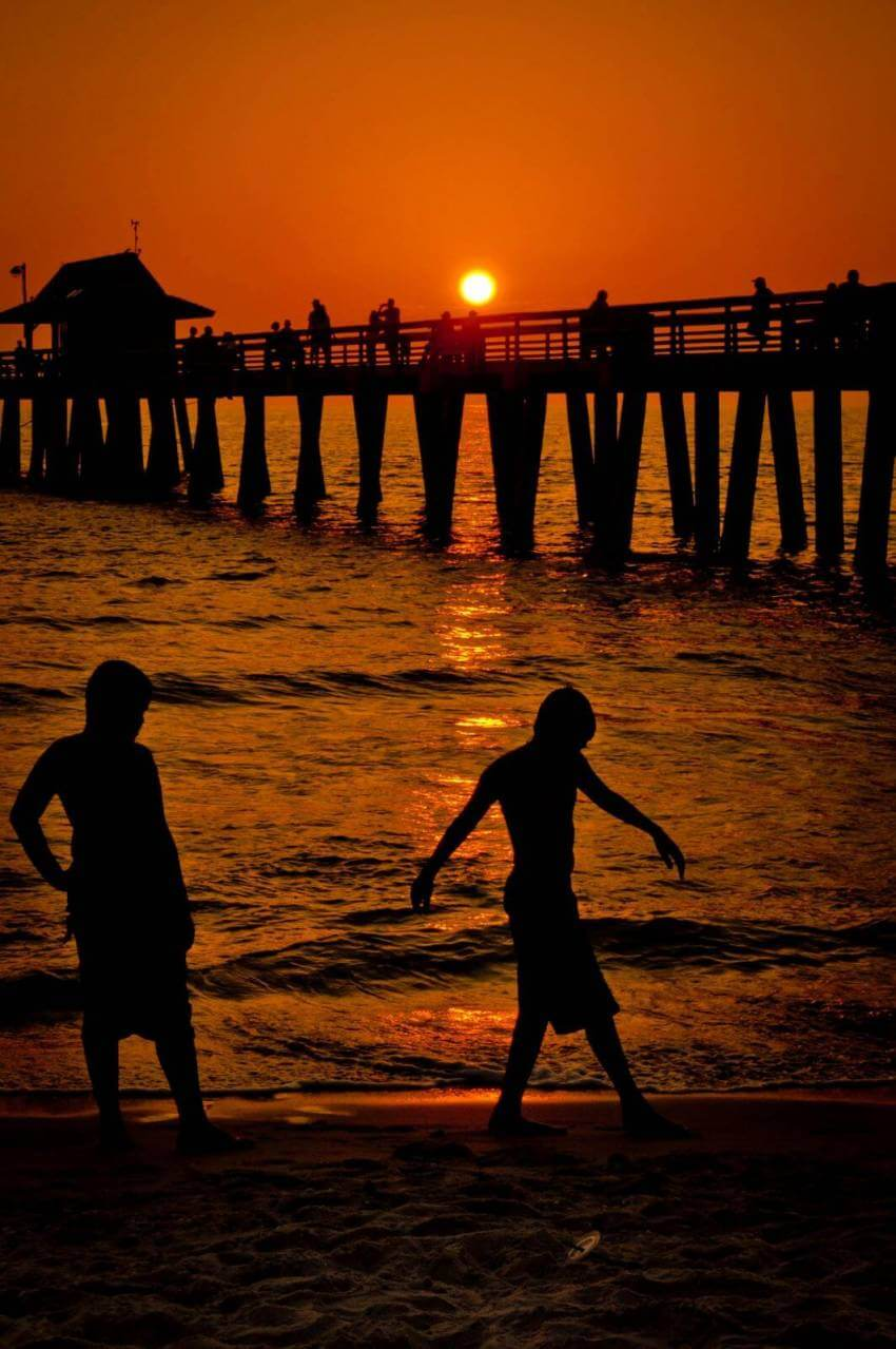 Sunset at Naples Pier in Naples Florida.