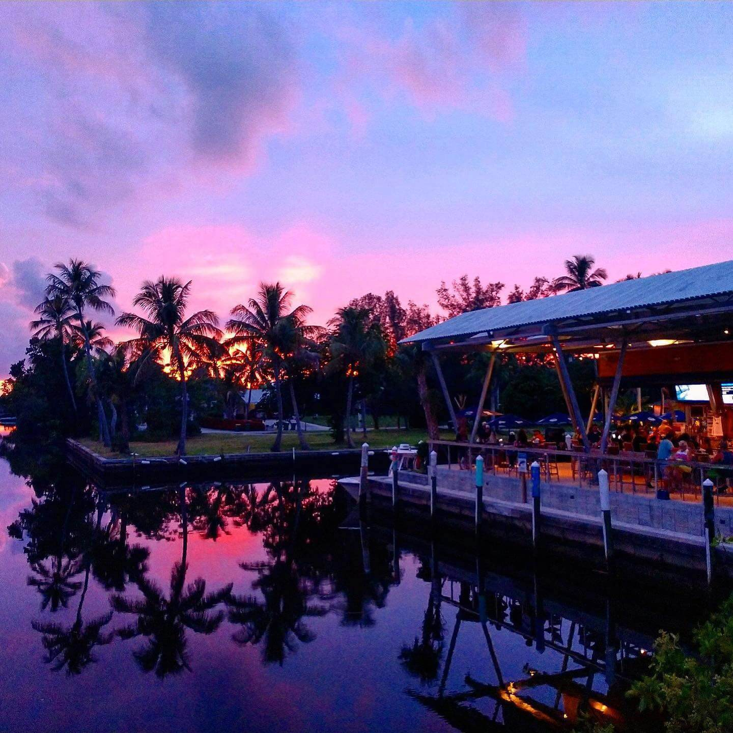 Sunset at Celebration Park waterfront bar and food truck park in Naples, Florida.