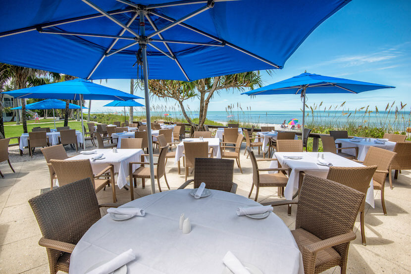 Waterfront outdoor dining at HB's on the Gulf located at The Naples Beach Hotel & Golf Club in Naples, Florida. Photo credit Jennifer Brinkman courtesy of The Naples Beach Hotel & Golf Club.