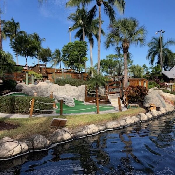 Play 18 holes of fun, adventurous, and challenging mini-golf in a lush tropical setting amid waterfalls, caves, pirate ships, and live alligators while on vacation in Fort Myers Beach, Florida.