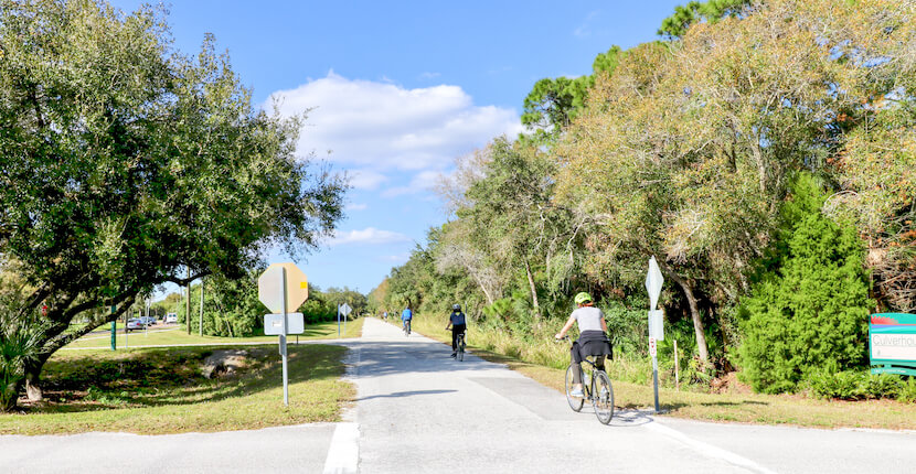 Bicycle riders on The Legacy Trail paved multi-use recreational trail for biking, hiking in Sarasota and Venice, Florida. Photo by Nita Ettinger. Must Do Visitor Guides | MustDo.com