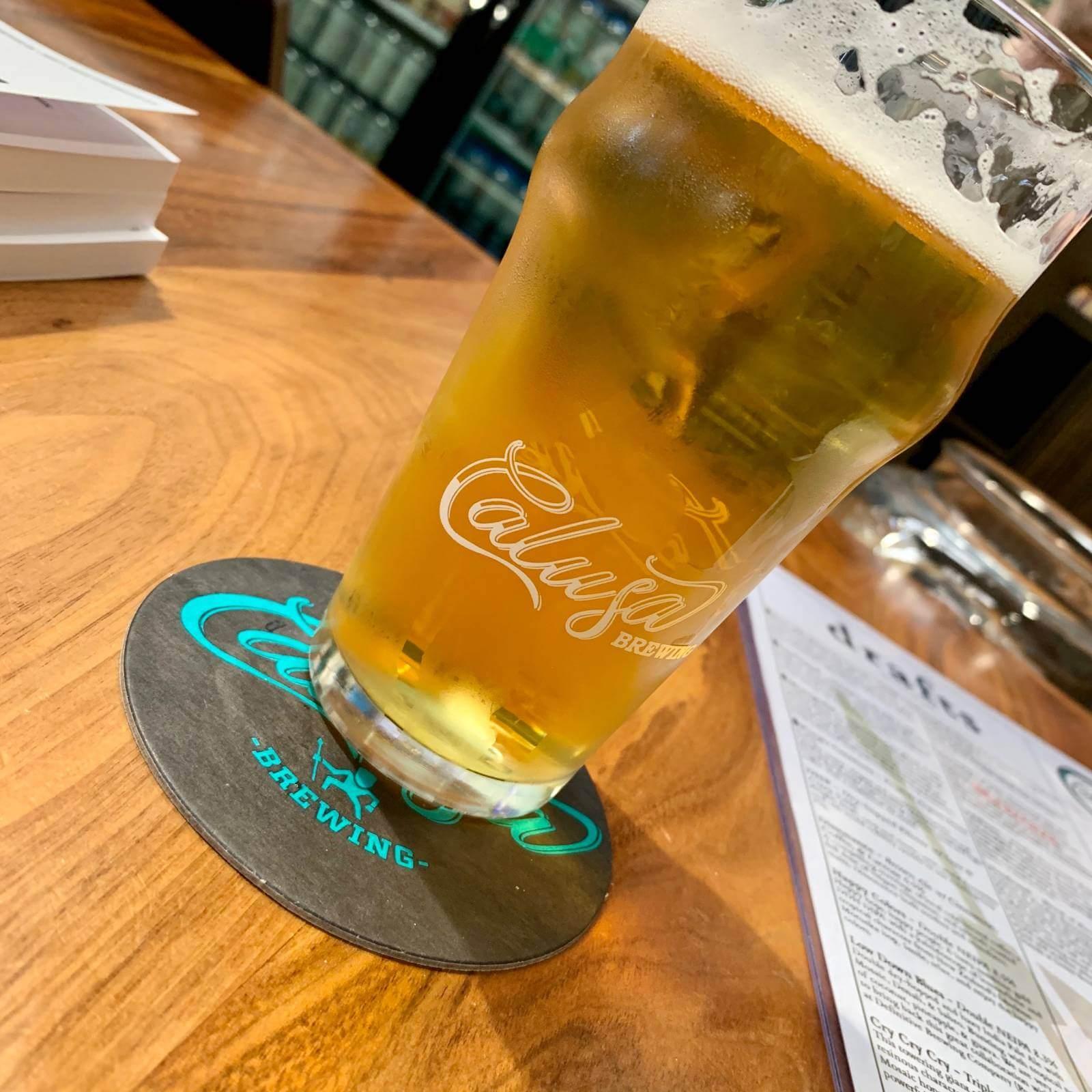 A cold glass of beer at Calusa Brewing in Sarasota, Florida. Photo credit dineSarasota/Larry Hoffman.