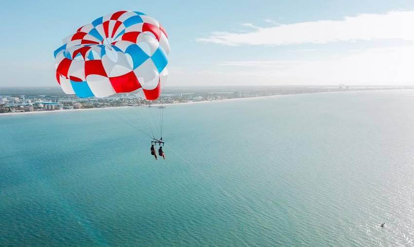 Soar above the Gulf along Fort Myers Beach, Florida on a parasail trip with Estero Island Parasail.