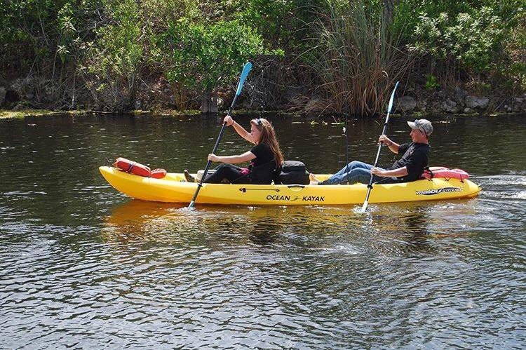 Couple kayaking in a yellow kayak in the Florida Everglades.