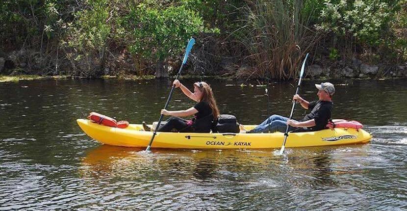 Couple kayaking in Florida Everglades.