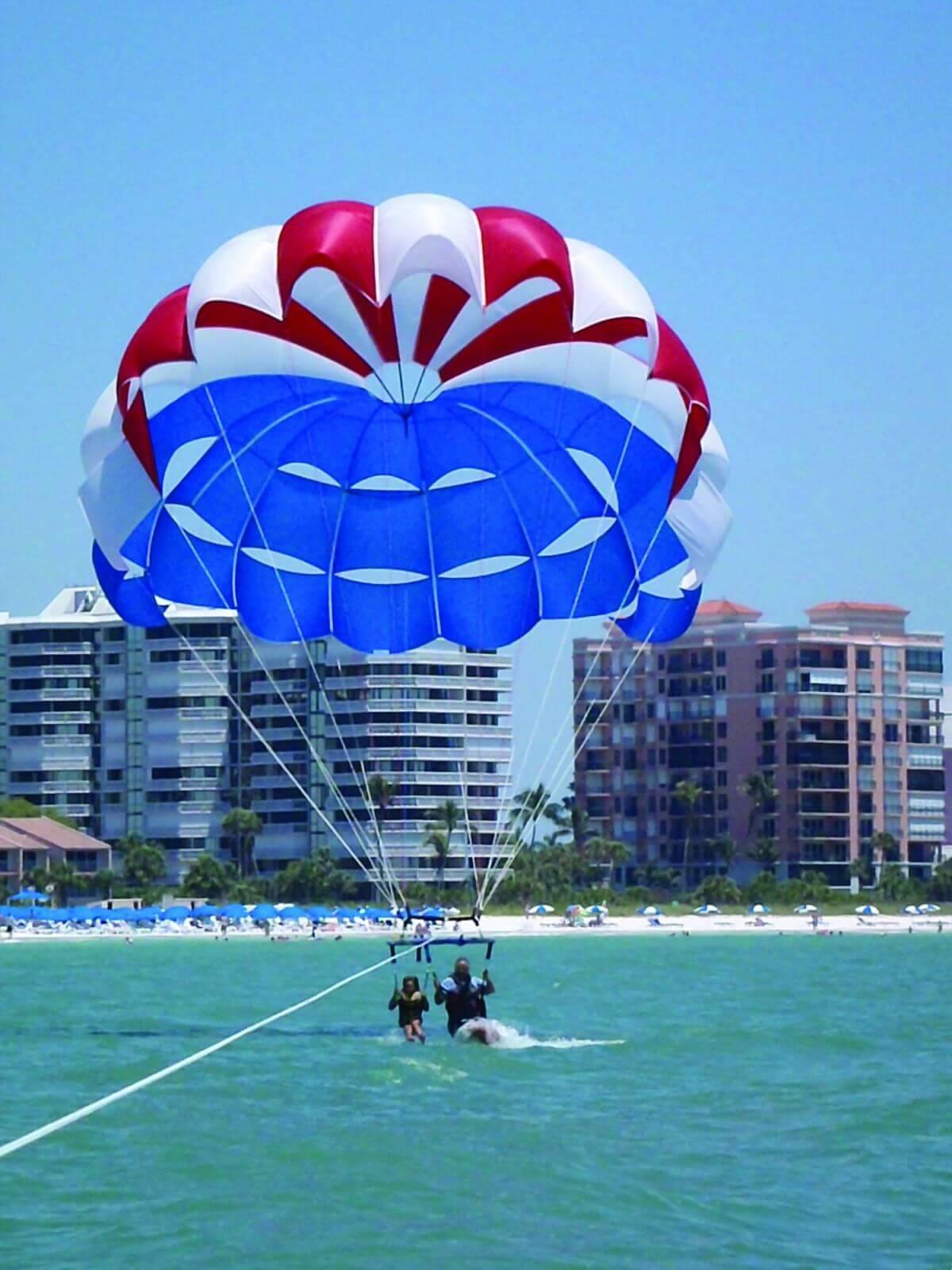 Parasailing along the beach in Marco Island, Florida.