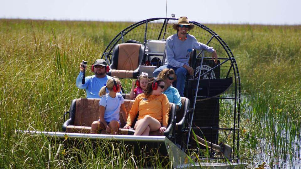 Family enjoying an airboat ride in the Florida Everglades with Everglades Swamp Tours near Naples, Florida.
