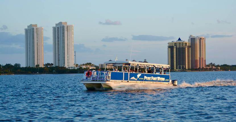 Pure Florida Narrated 90-minute Caloosahatchee River sunset cruise with views of Edison & Ford, downtown Fort Myers, Florida, bird rookeries, and mangroves.