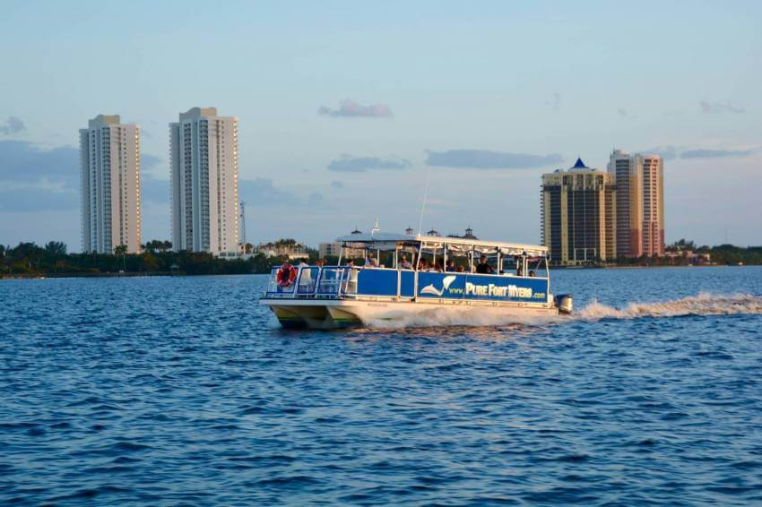 Sightseeing sunset cruise on the Caloosahatchee River near downtown Fort Myers with Pure Florida.