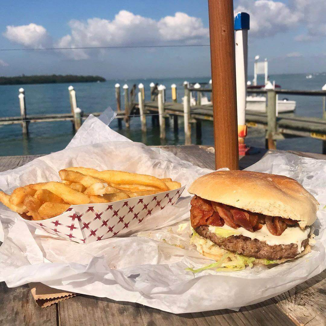 Cheap Eats in Sarasota - Bacon Cheeseburger and fries at New Pass Grill near Mote Aquarium in Sarasota, Florida. Must Do Visitor Guides | MustDo.com