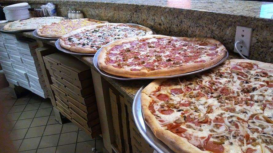 Cheap Eats in Sarasota - Whole or by the slice pizza from Patellini's Pizza downtown Sarasota, Florida. Must Do Visitor Guides | MustDo.com