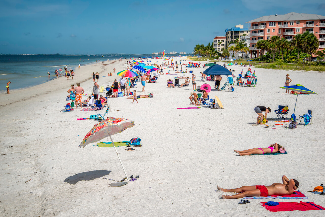Sunbathers on the white sand in Fort Myers Beach, Florida. Photo credit Jennifer Brinkman. Must Do Visitor Guides | Mustdo.com