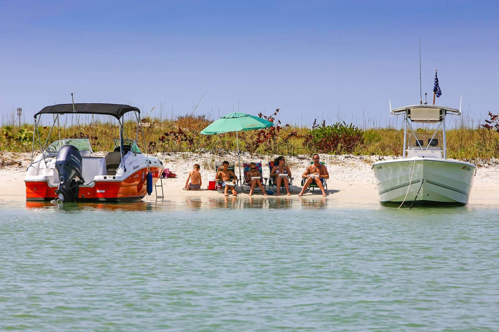 Boats mored at on the shore at Keewaydin Island near Naples and Marco Island, Florida. Photo by Chris L. Smith | Must Do Visitor Guides