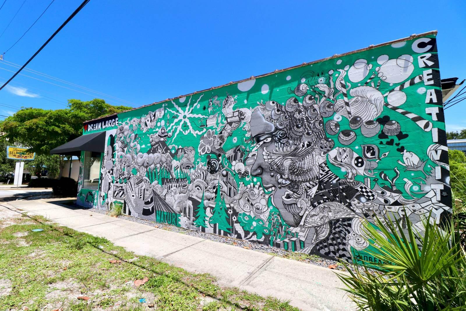 Dream Large surrealist mural Sarasota, Florida street art and murals. Photo credit Nita Ettinger. Must Do Visitor Guides | MustDo.com