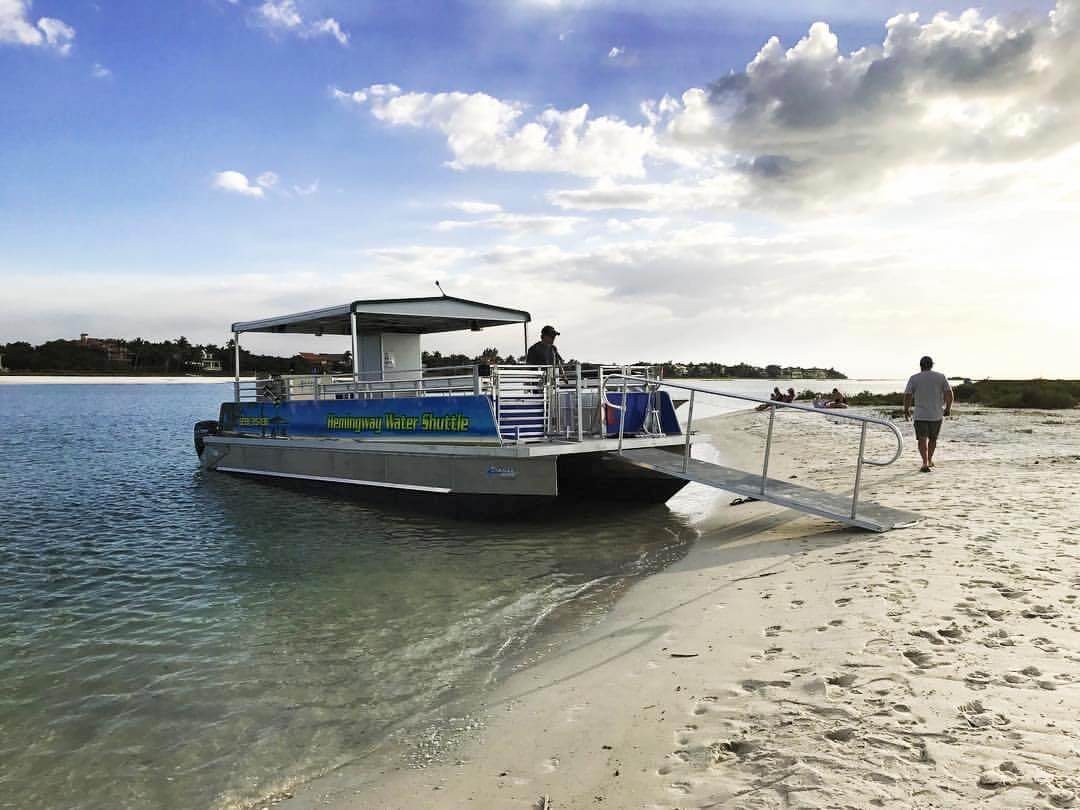 Hemingway Water Shuttle boat ferry to docked on the beach at Keewaydin Island, Florida. | Must Do Visitor Guides