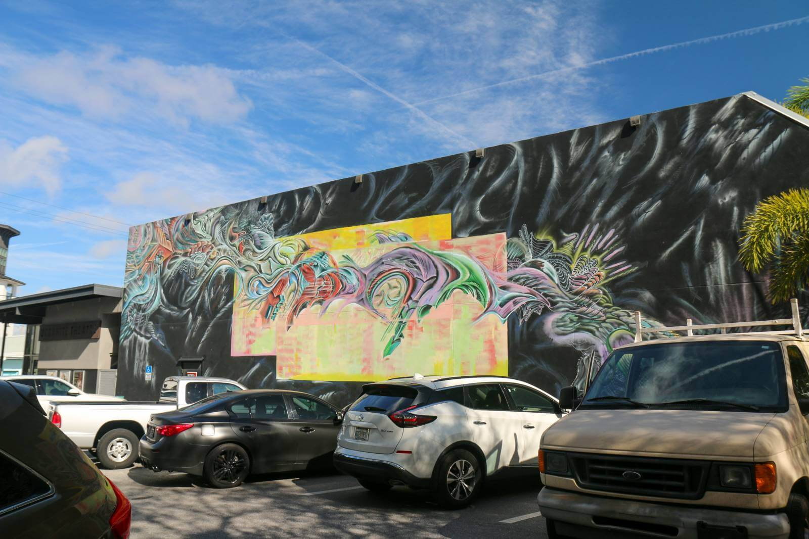 Mural of bright swirls of color set against a black backdrop at Kahwa Coffee Roasters downtown Sarasota, Florida Street art and murals. Photo credit Laurén Ettinger. Must Do Visitor Guides | MustDo.com