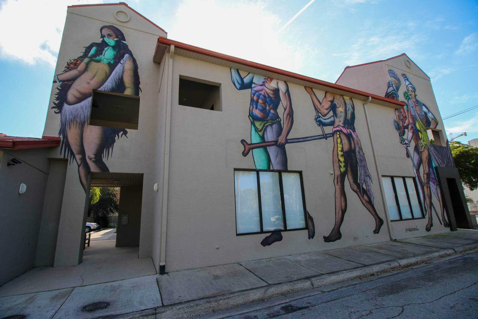 Richie Brasil larger-than-life depiction of Florida's earliest inhabitants - the Timucua Indians. Sarasota, Florida street art and murals. Photo credit Laurén Ettinger. Must Do Visitor Guides | MustDo.com