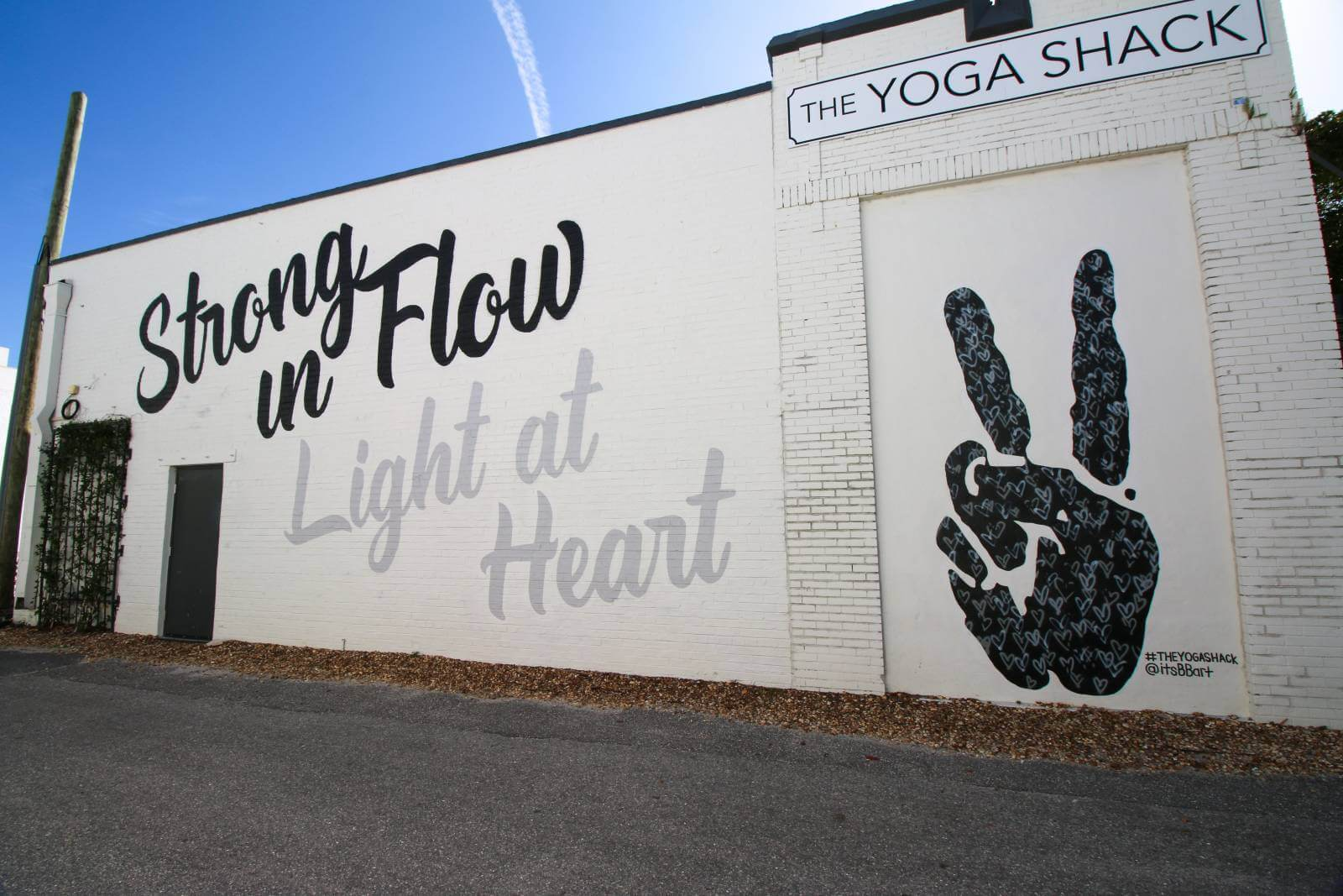 Stong in Flow Light at Heart The Yoga Shack. Sarasota, Florida street art and murals. Photo credit Laurén Ettinger. Must Do Visitor Guides | MustDo.com