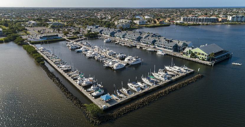 Aerial shot of Fishermen's Village Resort, Shopping, Marina, boat docks, and Vacation Villa Rentals in Punta Gorda, Florida.