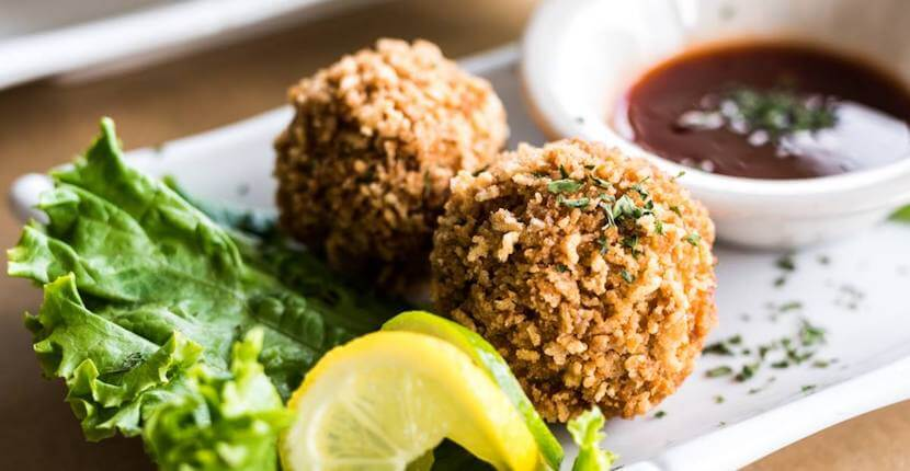 Stuffed crab balls. The Crabby Lady restaurant in Goodland, Florida. The menu features a variety of fresh local seafood, pastas, salads, burgers and more at this waterfront restaurant near Marco Island and Naples.