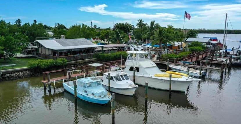 Enjoy lunch, dinner or drinks at the Crabby Lady a casual, open-air restaurant overlooking Goodland Bay and the Marco River in Goodland, Florida (near Marco Island and Naples).