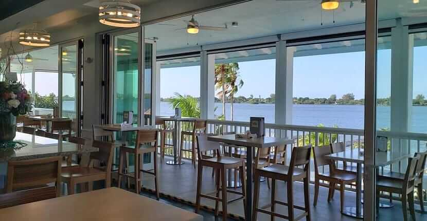 View overlooking the water at The Point, a casual three-story, open-air, waterfront restaurant and bar located in Osprey, Florida.