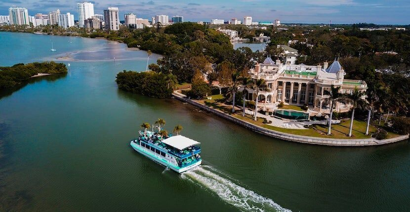 Relax and enjoy an educational and fun family-friendly narrated sightseeing, wildlife, or sunset cruise with live music, food, and drinks on a tour with LeBarge Tropical Cruises in Sarasota, Florida.