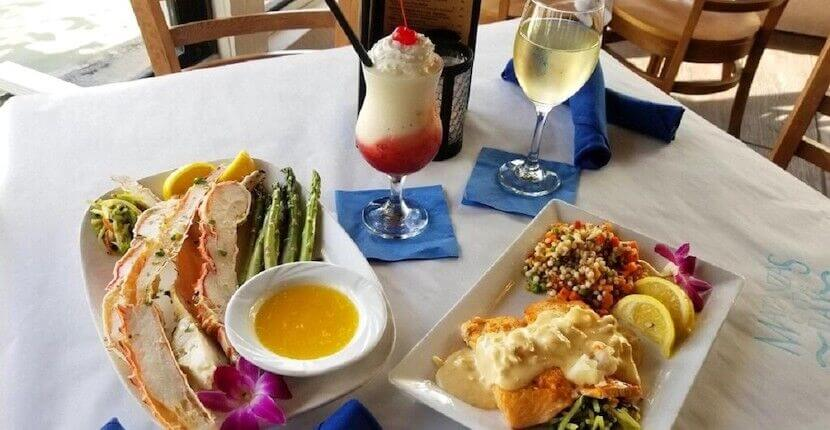 Seafood dinner and cocktails at Matanzas on the Bay waterfront restaurant in Fort Myers Beach, Florida.