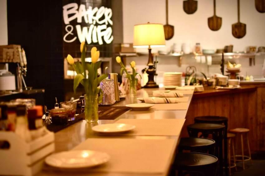 Dining and bar area at Baker & Wife restaurant in Sarasota, Florida.