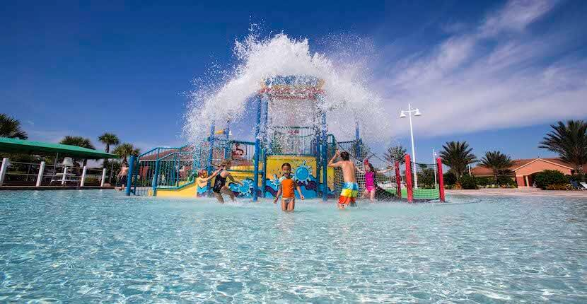 Children playing in kids water park in Ave Maria, Florida.