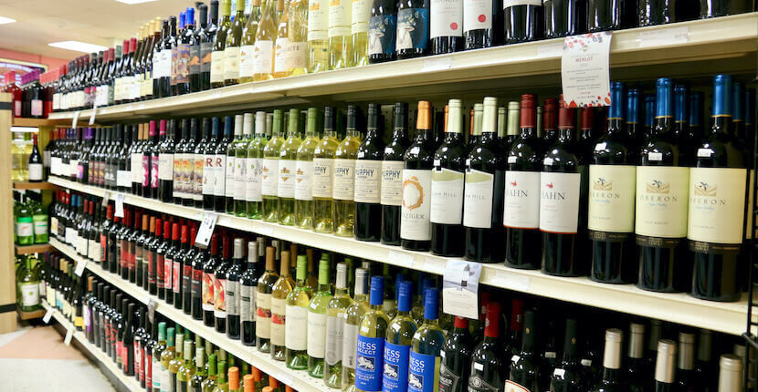 An array of bottles of wine on shelves at Crescent Beach Grocery in Siesta Key, Florida