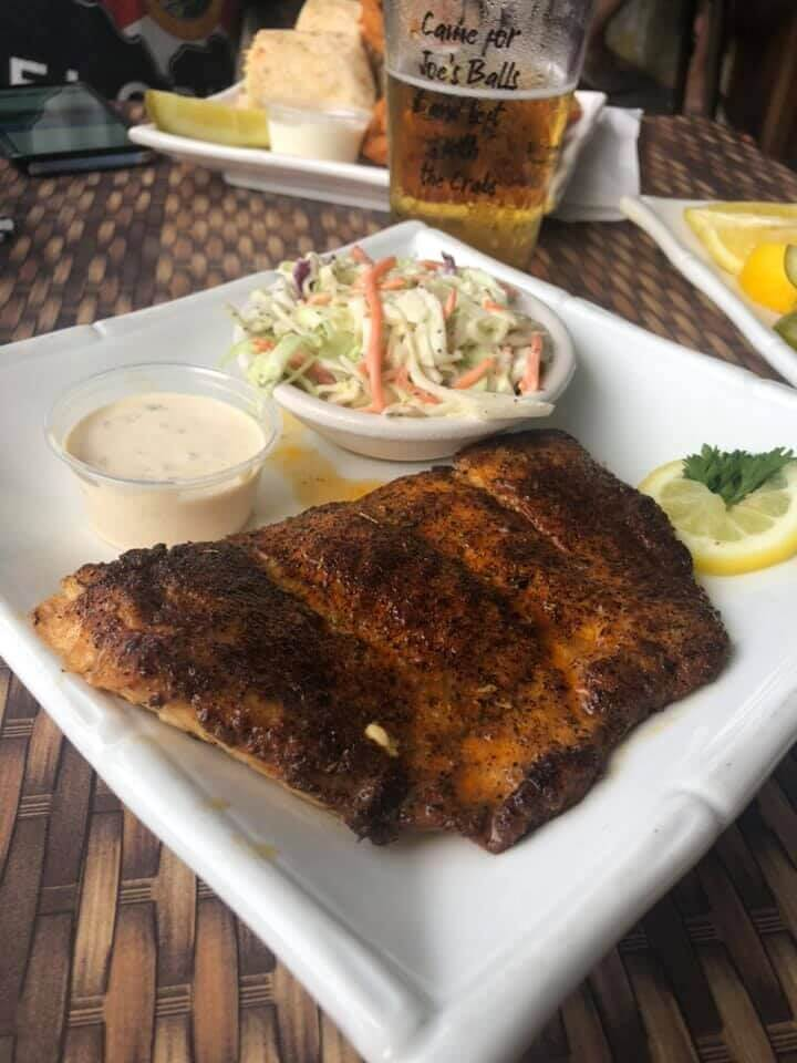 Grilled blackened fish with a side of coleslaw and dipping sauce entree Crabby Lady restaurant Goodland, Florida