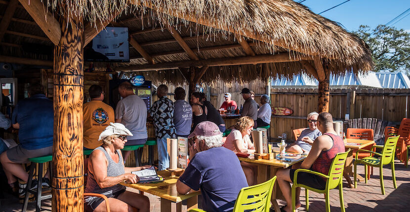 Live music, Happy Hour, and late night dining at Captain Curt's Sniki Tiki bar in Siesta Key, a tropical-themed bar with outdoor patio located near the beach.