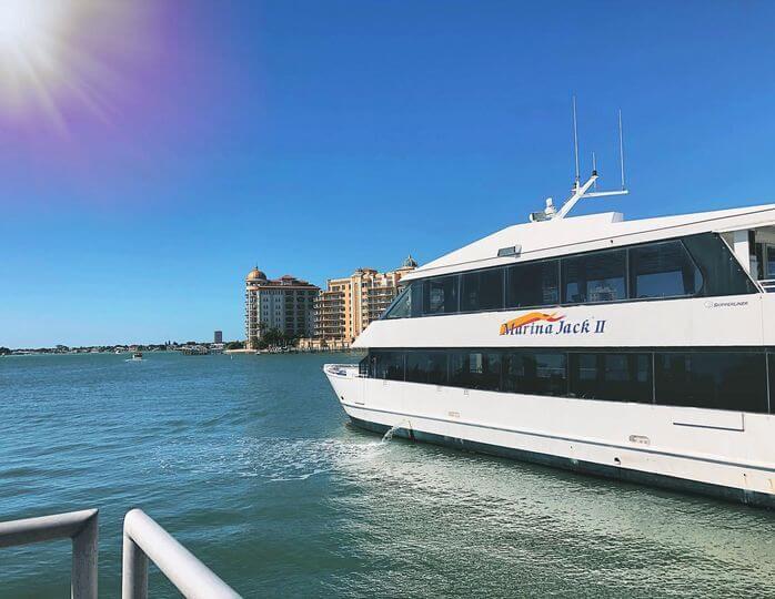 Marina Jack II sightseeing and dinner boat Sarasota Bay with blue sky and sunshine.