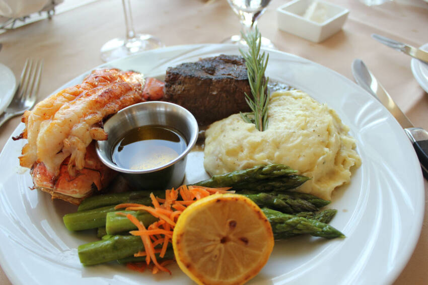 Marina Jack waterfront restaurant surf and turf entree with steak, lobster, asparagus and mashed potatoes